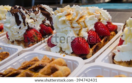 Belgian waffles with cream, berries and chocolate sauce