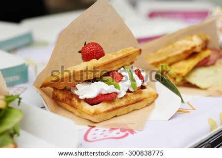 belgian waffles with fruits wrap in paper - stock photo