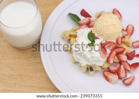 Belgian waffles with ice cream fresh strawberries and whipped cream.  - stock photo