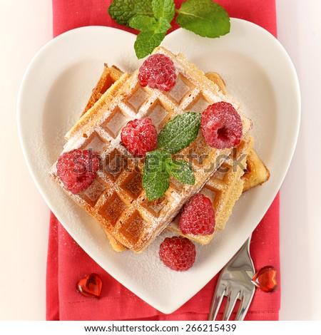 Belgian waffles with raspberry - stock photo