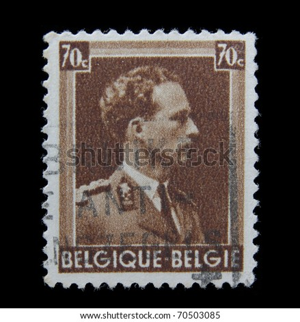 BELGIUM - CIRCA 1944: A post stamp printed in Belgium shows portrait of Leopold III, Crown and V, circa 1944