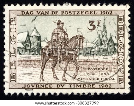 BELGIUM - CIRCA 1962: A stamp printed in Belgium shows Postrider, 16th Century, Belgium, circa 1962 - stock photo