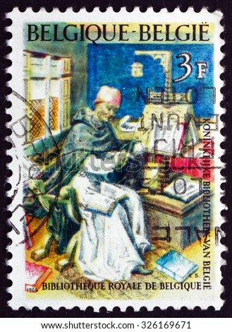 BELGIUM - CIRCA 1966: a stamp printed in the Belgium shows Medieval Scholar and Royal Library, National Scientific Heritage, circa 1966 - stock photo