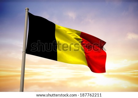 Belgium national flag against beautiful blue and yellow sky