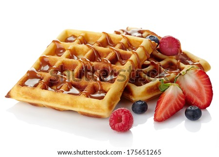 Belgium waffles with caramel sauce and fresh berries isolated on white background