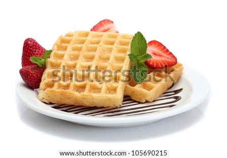 belgium waffles with strawberries and mint on plate isolated on white - stock photo