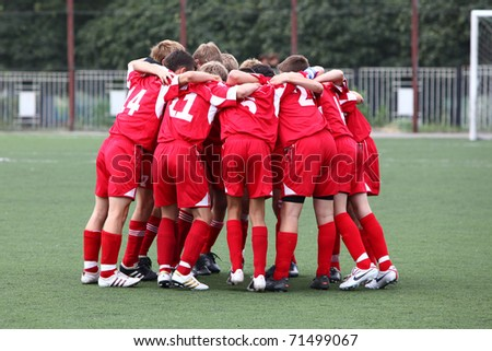 BELGOROD, RUSSIA - AUGUST 21: Unidentified boys embrace before football game on August, 21 2010 in Belgorod, Russia. The final of Chernozemje superiority, Football kinder team of 1996 year of birth. - stock photo