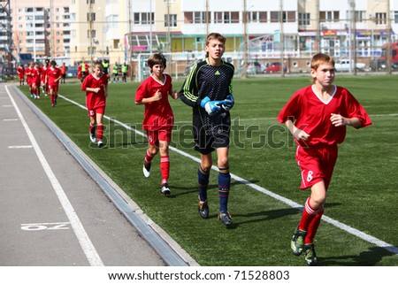 BELGOROD, RUSSIA - AUGUST 21: Unidentified boys  (football team) warming-up on August, 21 2010 in Belgorod, Russia. The final of Chernozemje superiority, team of 1996 year of birth. - stock photo