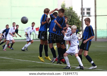 BELGOROD, RUSSIA - AUGUST 21: Unidentified footballers takes penalty kick on August, 21 2010 in Belgorod, Russia. The is the final of Chernozemje superiority, football team for kids born in 1996. - stock photo