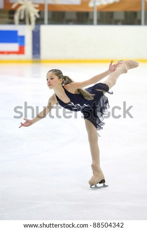 "BELGOROD, RUSSIA - DECEMBER 28: The young figure skater Sofia Lushpa performs in the ""The Father Frost prize"" competitions. on December 28, 2009 in Belgorod, Russia. - stock photo"