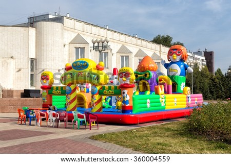 Belgorod, Russia - October 05, 2015: Children's inflatable playground - Crazy Penguin - in Belgorod. Street Popova - stock photo