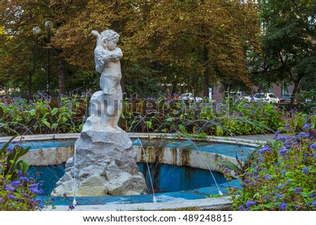 "BELGOROD, RUSSIA - SEPTEMBER 10, 2016: Holy Trinity Boulevard in Belgorod, Russia. Oldest sculpture fountain ""Girl with gosling"" (1953 year of construction)."