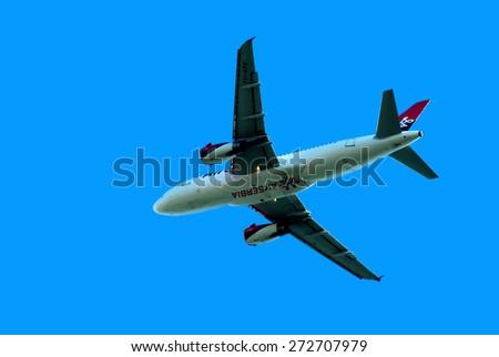 "BELGRADE-APRIL 25:Airbus A-319-100 jet climbing after take off from Belgrade airport "" Nikola Tesla "".April 25,2015 in Belgrade,Serbia - stock photo"