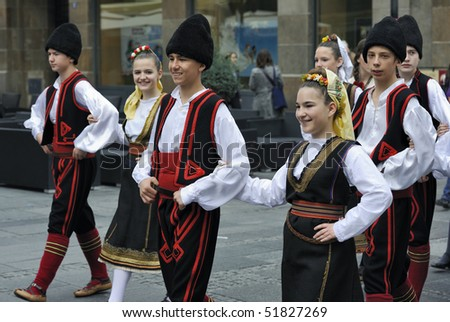 """BELGRADE - APRIL 24: Children in national costumes takes part in manifestation """"Right to smile"""" during """"Days of Belgrade""""  April 24, 2010 in Belgrade, Serbia. - stock photo"""