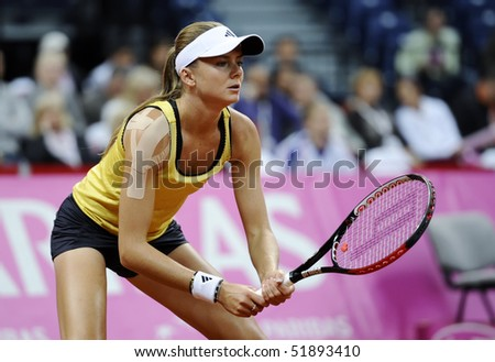 BELGRADE - APRIL 25: Daniela Hantuchova waits the ball from Jelena Jankovic during Fed Cup World Group Play-off  in Belgrade Arena April 25, 2010 in Belgrade, Serbia. - stock photo