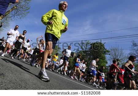 "BELGRADE - APRIL 18: Man runs during ""23. Belgrade Time Force marathon""  April 18, 2010 in Belgrade, Serbia. - stock photo"