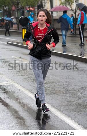 "BELGRADE-APRIL 18:""28th Belgrade Marathon"".Unidentified runner during a fun run race.On April 18, 2015 in Belgrade, Serbia  - stock photo"