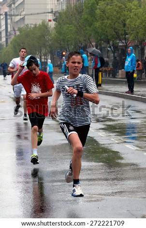 "BELGRADE-APRIL 18:""28th Belgrade Marathon"".Unidentified runners during a fun run race.On April 18, 2015 in Belgrade, Serbia  - stock photo"