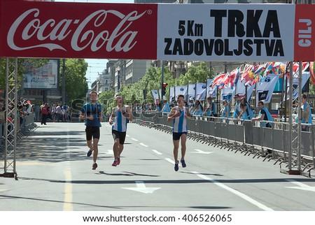 """BELGRADE-APRIL16: Unidentified competitors Finish Fun Rune race on""""29th Belgrade Marathon"""".On April 16, 2016 in Belgrade, Serbia  - stock photo"""