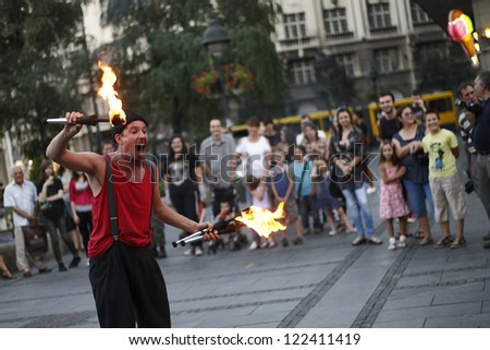 BELGRADE - AUG 26: Clown Barabba from Italia performs during Buskerfest, Street performers festival on August 26, 2011 in Belgrade, Serbia. - stock photo