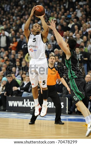 "BELGRADE - FEBRUARY 3: Curtis Jerrells of Partizan controls the ball during ""Euroligue top16 group G""  basketball match between Partizan and Montepaschi Siena February 3, 2011 in Belgrade, Serbia. - stock photo"