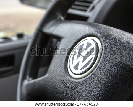 BELGRADE - FEBRUARY 19, 2014: Logo of popular German car manufacturer Volkswagen on steering wheel - stock photo