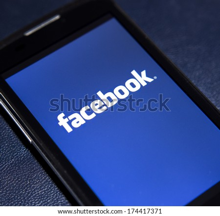 BELGRADE - FEBRUARY 02, 2014: Logo of popular social media website Facebook on smart phone screen - stock photo