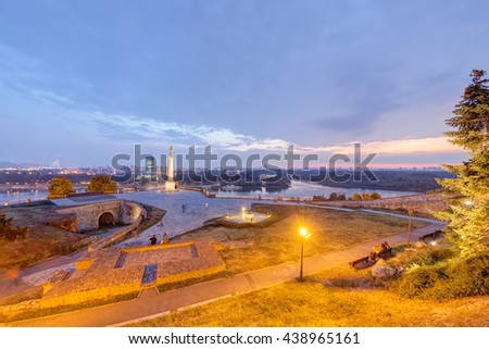 Belgrade fortress and panorama view on victor monument, at sunset - stock photo