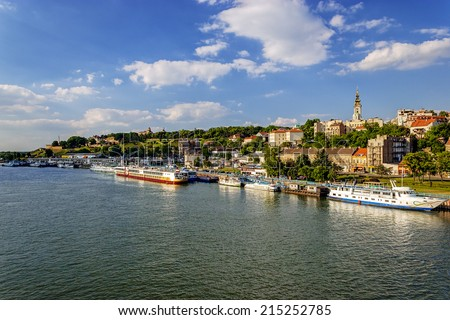 Belgrade from river Sava with tourist riverboats on a sunny day - stock photo