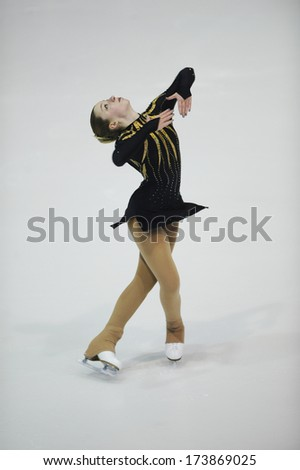 "BELGRADE - JANUARY 24: Austria's Isabella Riegler performs her short program at  Europa Cup figure ice skating competition ""Skate Helena"" in Belgrade, Serbia on January 24, 2014 - stock photo"