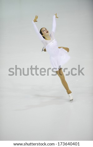 "BELGRADE - JANUARY 24: Bulgaria's Teodora Markova performs her short program at  Europa Cup figure ice skating competition ""Skate Helena"" in Belgrade, Serbia on January 24, 2014 - stock photo"