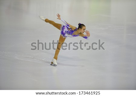 "BELGRADE - JANUARY 23: Hungary's Mira Barath performs her free skating program at Europa Cup figure skating competition ""Skate Helena"" in Belgrade, Serbia on January 23, 2014 - stock photo"