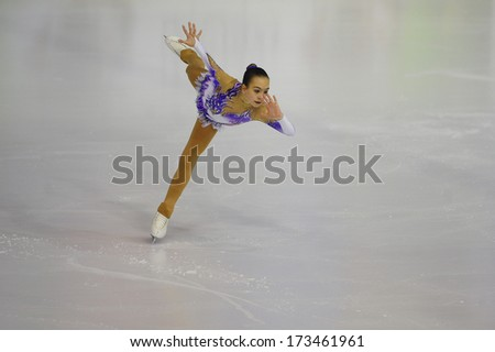 "BELGRADE - JANUARY 23: Hungary's Mira Barath permorms her free skating program at Europa Cup figure skating competition ""Skate Helena"" in Belgrade, Serbia on January 23, 2014 - stock photo"