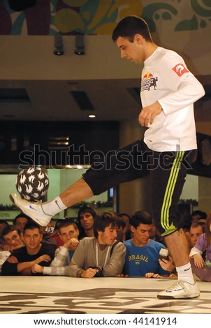 BELGRADE - JANUARY 9: RED BULL STREET STYLE SOCCER CONTEST,Competitor showed finesse with ball, January 9, 2010 in Belgrade, Serbia - stock photo