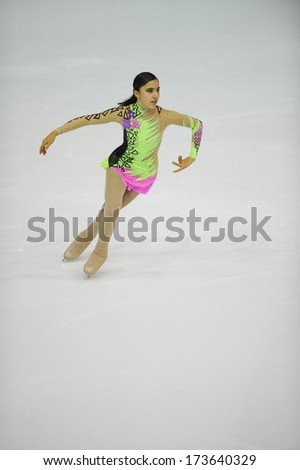 "BELGRADE - JANUARY 24: Turkey's Elif Erdem performs her short program at Europa Cup figure ice skating competition ""Skate Helena"" in Belgrade, Serbia on January 24, 2014 - stock photo"