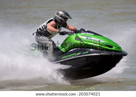 "BELGRADE-JULY5:Driver Igor Perazic ( SRB ) during the race on "" Balkans Jet Ski Championship-2014"".On July 5,2014 in Belgrade,Serbia  - stock photo"