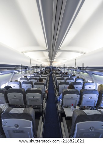 BELGRADE - JULY18: interior of a AIR SERBIA Boeing 737 before take off on July 18, 2014 in Belgrade, Serbia. The 737 series is the best-selling jet airliner in the history of aviation. - stock photo