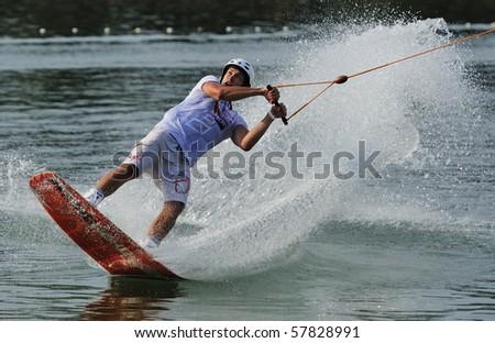 """BELGRADE - JULY 3: Stefan Lalic rides wakeboard during """"Belgrade International CWWC Wakeboard Stop by IWWF"""" July 3, 2009 in Belgrade, Serbia. - stock photo"""