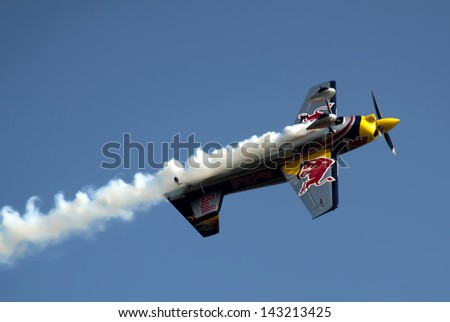 "BELGRADE-JUNE 22: Matijas Doldere in acrobatic flight on the""1st Red Bull Flugtag in Serbia"".June 22,2013 in Belgrade, Serbia - stock photo"