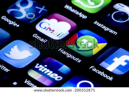 BELGRADE - JUNE 23, 2014 Popular social media icons hangouts gmail and other on smart phone screen close up - stock photo