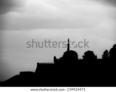 Belgrade Kalemegdan fortress panorama silhouette, Statue of Victory is a monument in  erected on 1928 to commemorate the Kingdom of Serbia's war victories over Ottoman Empire , Serbia - stock photo
