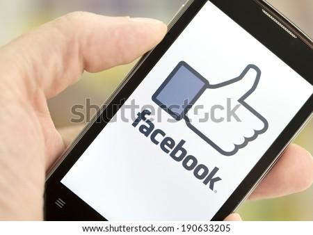 BELGRADE - MAY 03, 2014: Logo of popular social media website Facebook on smart phone screen - stock photo
