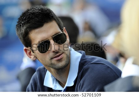 "BELGRADE - MAY 9: Novak Djokovic in the public during ""Serbia Open 2010"" ATP World Tour final match between Sam Querrey and John Isner May 9, 2010 in Belgrade, Serbia. - stock photo"