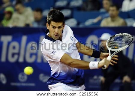 "BELGRADE - MAY 6: Novak Djokovic returns the ball during ""Serbia Open 2010"" ATP World Tour match against Fabio Fognini May 6, 2010 in Belgrade, Serbia. - stock photo"
