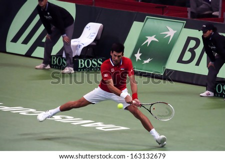 BELGRADE-NOVEMBER 15:Player N.Djokovic (SRB) return a ball during a match against R.Stepanek (CZE) in final Davis Cup Serbia-Czech Republic.N.Djokovic won 3:0,on November 15,2013 in Belgrade,Serbia  - stock photo