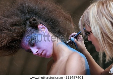 """BELGRADE - OCTOBER 10: Girl with modern hairstyle is seen during """"19th international congress and cosmetics fair""""  October 10, 2005 in Belgrade, Serbia. - stock photo"""