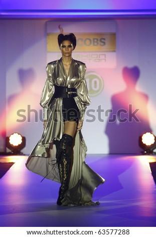 "BELGRADE - OCTOBER 19: Model wears dress from Nenad Sekirarski collection during ""Jacobs Fashion Selection"" show on October 19, 2010 in Belgrade, Serbia. - stock photo"
