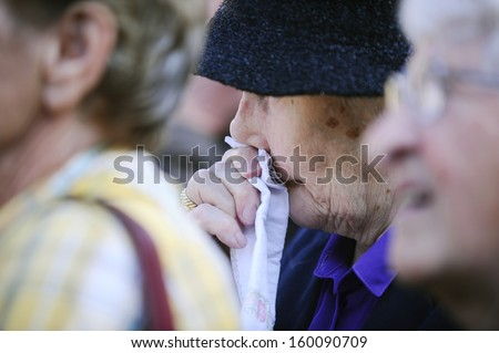BELGRADE - OCTOBER 26: Woman cries at funeral, Former Yugoslavia's first lady Jovanka Broz was laid to rest Saturday near the grave of her husband Josip Broz Tito in Belgrade, Serbia, October 26, 2013 - stock photo
