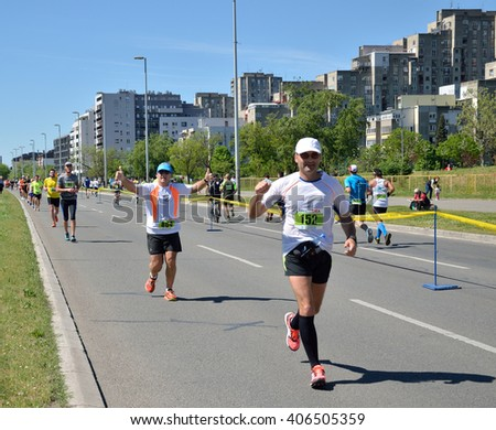 Belgrade, Serbia - April 16, 2016: 29th Belgrade Marathon. A group of runners during marathon race. Winners are Abel Kibet Rop, with time 2:23:58, and Stella Barsosio, 2:43:41, both from Kenia. - stock photo