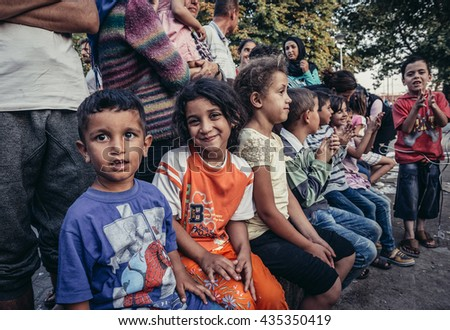 Belgrade, Serbia - August 29, 2015. Children in a makeshift refugee camp in one of the parks in Belgrade - stock photo